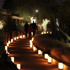 A simple pathway lighting idea. Use brown lunch sacks with rectangular light base luminary lights inside! Your guests will never realize it's normally something you carry a PB & J in!