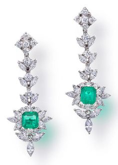 A pair of emerald and diamond pendant earrings  each designed as a cut-cornered rectangular-cut emerald, marquise and round brilliant-cut diamond cluster suspended from a marquise and round brilliant-cut diamond line; estimated total emerald weight: 1.55 carats; estimated total diamond weight: 3.45 carats; mounted in eighteen karat white gold