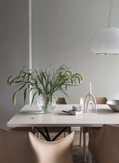 A dining room in neutrals in the calm home of a Swedish architect
