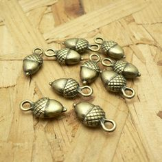 10 Walnut Charms Antique Brass Tone 3D A218 by CharmShopCrafts on Etsy