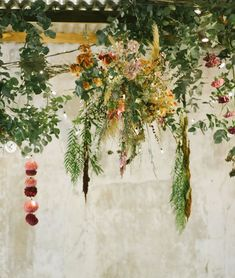 hanging flower installation, wedding reception- January 2020, proof that flowers do not last out here in summer. kept the arrangements in the air-coned office until the very last minute and they still looked sad by the time the photographer snapped them. floral styling and wedding decor from concept to completion. Flower Installation, Floral Style, Wedding Reception, Wedding Decorations, January, Sad, Concept, Wreaths, Flowers