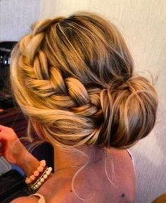 Braided hair pulled into a bun