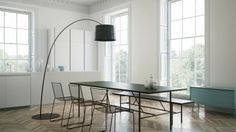 Minimal Dining with arc floor lamp in black and blonde herringbone flooring