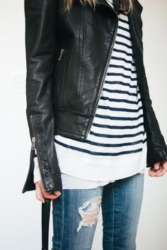striped sweater with black leather jacket and broken jeans.