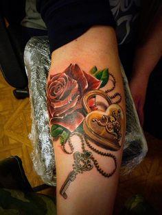 Rose, lock and key tattoo, beautiful piece by artist Roman Kuznetsov, Moscow Russia