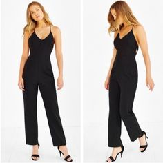 Urban Outfitters Racerback Jumpsuit Urban Outfitters Racerback Jumpsuit. Dramatically chic jumpsuit from the modern Silence + Noise collection. In a slim, tailored fit with a v-neck and skinny cutout-accented racerback. Finished with a back zip closure.  Content + Care - Rayon, polyester, spandex    - Hand wash  - Imported Urban Outfitters Pants Jumpsuits & Rompers