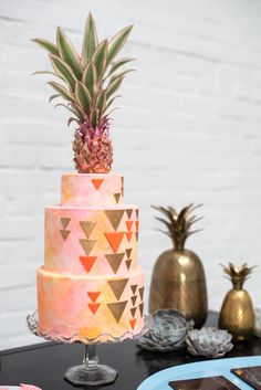 We were obsessed the moment we laid eyes on this cake when it appeared on set for our V5 issue. Details such as gold and neon triangles over the blush watercolor treatment, finished with a (real!) pineapple topper earned this cake a spot on our Best Of list.