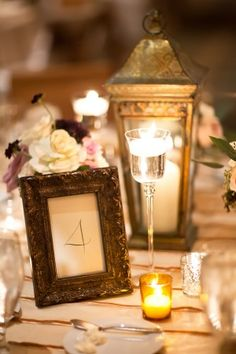 A lovely wedding with vintage touches (love the lanterns and antique picture frame table numbers)