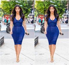 Kim K wearing one of her favorite blue Kardashian Kollection dresses!