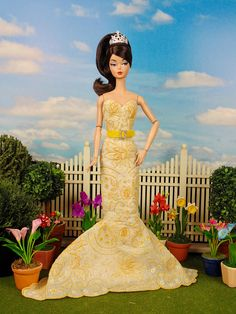 Fully lined, fitted gown with strapless bodice and long mermaid skirt. Dress is sewn entirely by hand from an exquisite vintage, hand-embroidered wedding hankie with yellow stitching on a white background. Dress is lined and fastened with metal snaps. Hand embroidery absolutely covers the entire gown. Includes rhinestone ring tiara and ultrasuede belt with rhinestone buckle. This fashion is specially made to fit: - Silkstone Barbie - Victoire Roux - Fashion Royalty Color Infusion - Poppy…
