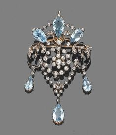 A belle epoque aquamarine and diamond brooch/pendant, circa 1910  The openwork cartouche set with rose-cut diamonds and pear-shaped aquamarines, suspending a cicular millegrain-set old brilliant-cut diamond swag centre and terminating in three collet-set rose-cut diamond and pear-shaped aquamarine drops, mounted in silver and gold, diamonds approx. 0.70ct. total, length 6.0cm. by chrystal