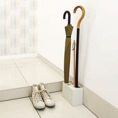 "Umbrella stand ""kasa+"". umbrella and stick and shoehorn."