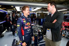 Keanu Reeves Photos Photos - Actor Keanu Reeves speaks with Sebastian Vettel of Germany and Infiniti Red Bull Racing in the team garage after final practice for the United States Formula One Grand Prix at Circuit of The Americas on November 1, 2014 in Austin, United States. - F1 Grand Prix of USA - Qualifying