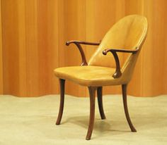 Curved armchair, Designed 1936, by Frits Henningsen