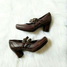 Brown Clarks Artisan Leather Mary Jane Heel *Excellent condition *Brown Leather Shoes *Comfortable Square Toe *Mary Jane Style *Wood Stacked Heel *Rubber Exterior Soles, in great condition *Two Buckles on each shoe with adjustable size strap *Size 6M   Heel height: 2 inches Hidden Platform: 1 inch  *Condition score 8 of 10 -Very minor signs of wear when closely inspected  Feel free to ask questions or make offers!  Clarks Shoes Heels