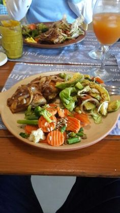 Chicken with my homemade sauce and onions salad and country veggies .