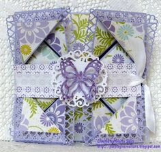 See my blog for tutorial for this card.  http://purpleglocreations.blogspot.com.  Multi-Fold Card For Any Occasion Using Cricut Artiste Cartridge