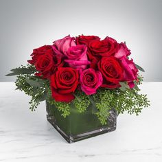 Sparks fly and so will her heart. This rose combination is flirty, yet romantic. Sparks Fly by BloomNation™ the perfect gift for your Valentine's Day. Arrangement Details: Includes a dozen roses in hot pink and red. APPROXIMATE DIMENSIONS: H, W, Flowers Online, All Flowers, Beautiful Flowers, Send Flowers, Valentine's Day Flower Arrangements, Diy Gifts For Girlfriend, Corporate Flowers, Rose Centerpieces, Valentines Flowers