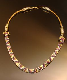 Woven wire collar in blues purple and brass by DahyiitihiArts