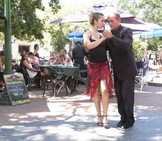 A Turkish student of the tango dances with her professor for cafe-goers in Buenos Aires, Argentina.
