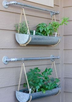 hanging garden on the wall using galvanizd planters from West Elm - Shelterness