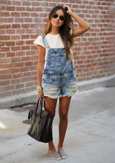 Over it all. I've been flirting with the idea of trying this comeback trend for a while now. And I think July is the best time to wear your overalls. Look for a distressed pair with a little personality at a thrift store.