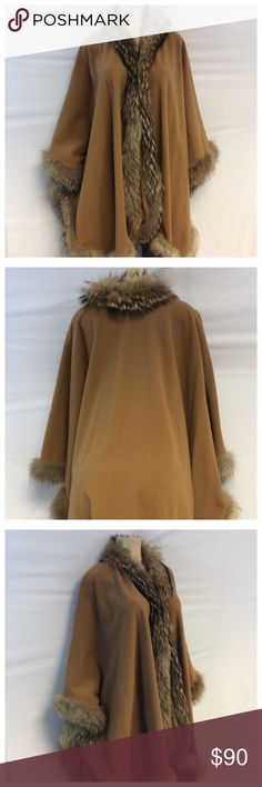 WOMENS FUR EDGED CAPE/PONCHO WOMENS FUR EDGED CAPE/PONCHO. German size 40 (M), 70% wool, 30% polyester, dry clean. Believe fur to be attic fox but not for sure. 0125 Jackets & Coats Capes