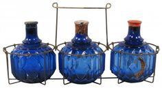 Three Hayward's Fire Grenades in wire rack