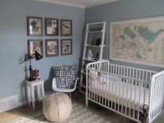 An eclectic nursery that is serene and masculine and successfully combines all the trends: maps, modern, vintage, chevron, geometric ...