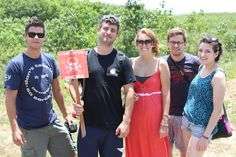 """Group of tourist posed for group memorable  photo after watching a live unexploded ordnance (UXO) disposal in Cam Lo Dis., Quang Tri Prov., Vietnam, along the former DMZ during Vietnam War. Earlier, delegate paid a visit at the Mine Action Visitor Center to review overall post war bombs and mines  situation basing in Dong Ha city. This type of tour is only offered  by Vietnam Backpackers Hostels via its tour code  """"Buffallo Run""""."""