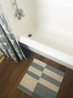 """A 100% Reversible Rental Bathroom Makeover For Under $500 — Apartment Therapy Original Makeover  -- Vinyl """"Wood"""" floors (removable)"""
