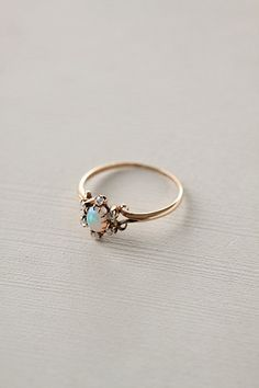 Opal & Diamond Flower Ring #anthropologie I would want to wear this every second of every day its so beautiful! :O .