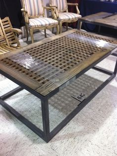 Diy, you could use decorative lattice, frame in the sides, and use wooden posts unless you know how to weld