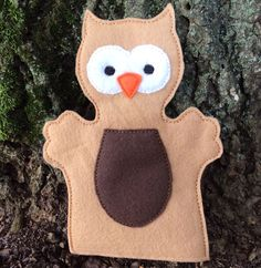 You are looking at an owl hand puppet. This is one individual puppet, available in two sizes!    The adult size is large enough to fit an adult