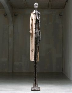 American artist John Baldessari re-introduces nine 4,5 meter-tall Alberto Giacometti statues. Apart from making them particularly tall, he then proceeds to dress them; and, therefore, infuse various personalities unto them. The Giacometti Variations by John Baldessari at Fondazione Prada, Milan; October 29 - December 26, 2010.