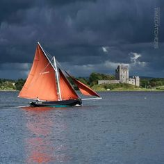 Galway Hooker sailing past Dunguaire Castle, Kinvara, Co Galway, by unknown author. Repinned by WI/IE. _____________________________Do feel free to visit us on http://www.wonderfulireland.ie/west/kinvara/#/ for lots more pictures and stories of beautiful Ireland
