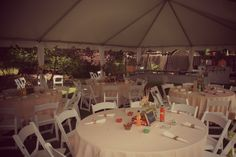 """For a #country #chic & fun"""" themed #Engagement Party, Sarah & Ben wanted guests to join in on the fun. To accomplish that, we placed classic games on each table along with handmade #centerpieces filled with gerbera daisies and baby's breath, and napkin rings."""