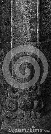 Shot in black and white, detail on an sculpture placed on a pillar on the inside garden of this historic building, set in Gothic district, Barcelona, Catalunya, Catalonia, España, Spain, Europa, Europe