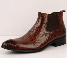 Chelsea boots are a staple for any fashionable guy's style. The crown crocodile patterned patent leather of these boots - NEAT!!