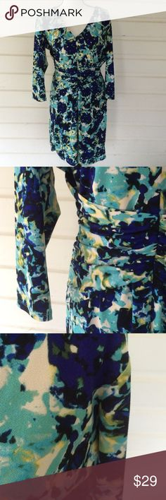 "Ann Taylor Blue Floral Dress Fully lined blue floral print dress. Beautiful shades of blue combine to make a unique yet classy dress. Cinched at the waist and zip up in the back. 3/4 length sleeves.underarm to underarm-18 1/2"", length-36"", waist-14"". Offers warmly received. Ann Taylor Dresses Midi"