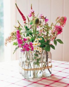 37 DIY Floral Arrangements for Adding Some Flower Power to Your Home This arrangement—featured in Decorating with Flowers by Paula Pryke—gets its charm from vintage milk bottles tied together with gardener's twine. Easter Flower Arrangements, Easter Flowers, Beautiful Flower Arrangements, Diy Flowers, Vintage Flowers, Spring Flowers, Flower Decorations, Floral Arrangements, Flowers Vase