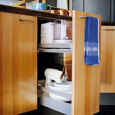 Store small appliances according to how you use them by keeping the most-used items close at hand and others stored neatly away.