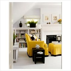 loving the cloudy walls and mustard chair