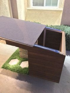 Custom made Dog House. Made will all outdoor material. Sliding roof for easy cleaning. Laminated tile inside. Solar powered lights. Material: - Oak - Natural Stone - Synthetic Grass - Asphalt Shingles Size: Base of House: 31W x 39L x 22 - 27H (the roof slants up) If this is not your style, we can definitely make anything or adjust anything to fit your needs.