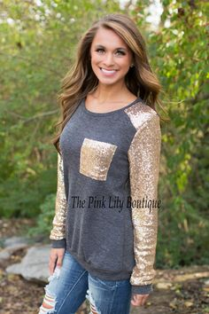 The Pink Lily Boutique - Charcoal Sequin Sleeve Blouse, $38.00 (http://thepinklilyboutique.com/charcoal-sequin-sleeve/)