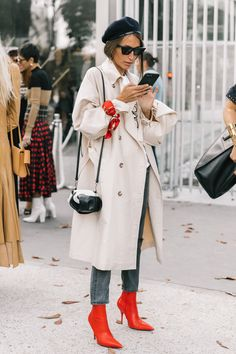 Love this trench paired with a beret and bright red boots