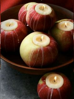 Thanksgiving centerpiece. Cut out the center of an apple just big enough to hold your mini candle and you have a great centerpiece!