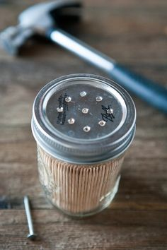 Ideal for the finger food at your next dinner party, this toothpick dispenser can be made by simply poking holes in the lid of a small Mason jar.
