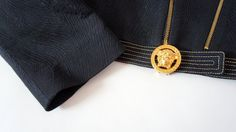 Hello Im glad youre here VINTAGE PANDORA  I offer vintage VERSACE JEANS COUTURE jacket AUTHENTIC !  color:navy blue interwoven with gold thread gold large medusa head Made in Italy size on tag -L 70% acetato 20% acrylic 10% metal lining 95% poliester 5% altre fibre used in very good condition   total length 50 cm/ 19,69 inch width shoulders 43 cm/ 16,93 inch width armpit to armpit 52 cm/ 20,47 inch length sleeves 63 cm/ 24,80 inch length sleeves from armpit 45 cm/ 17,72 inch   If you have…
