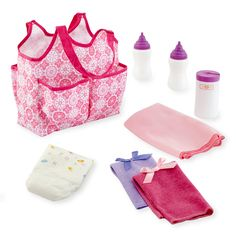 "This You & Me Doll Accessories Tote Bag, a Toys 'R' Us exclusive, makes it easy to take your baby doll anywhere. The nine-piece set includes two bottles, one diaper, two soft clothes, a changing blanket, and a container for baby wipes. Everything fits neatly into the pretty, bright pink tote, which can be carried on one shoulder, leaving both of your hands free to take care of your baby doll. Dimensions: 7L x 4.5""W x 5D. Weight: 7.5 oz.<br><br><b>You & Me</b> baby dolls, baby doll clothes…"